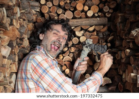 winking man sharpening his axe - stock photo