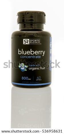 Winneconne, WI - 13 December 2016:  Bottle of Sports Research blueberry concentrate softgels on an isolated background.