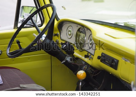 WINNECONNE, WI - JUNE 1:  Inside of a 1970's Yellow U.S. Flag Ford Truck at Annual Car Show on Main Street June 1, 2013 in Winneconne, Wisconsin. - stock photo
