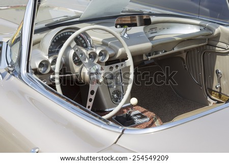 WINNECONNE, WI - JUNE 7:  Interior of 1962 Fawn Beige Chevy Corvette at Winneconne Annual Car Show Public Event June 7, 2014 in Winneconne, Wisconsin. - stock photo