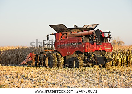 Winneconne, WI - 22 October 2104: A Case axial flow combine sits in the field getting ready to harvest corn. - stock photo