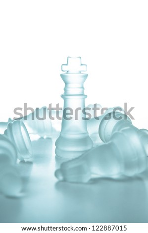 Winner and leadership concept, glass chess piece king on a white background isolated. - stock photo