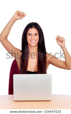 Winner brunette girl with a laptop isolated on a white background