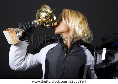 Winner drinking champagne from gold cup after race