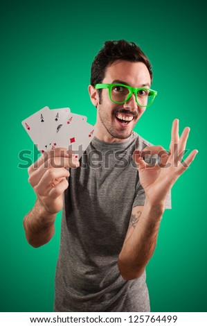 winner guy holding poker cards on green background