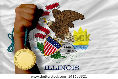 Winner holding gold medal for sport and flag of us state of illinois - stock photo