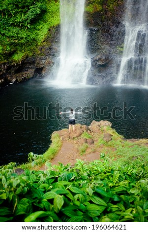 Winner near waterfall. Sport and active life concept - stock photo