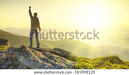 Winner on mountain peak. Sport and active life concept - stock photo