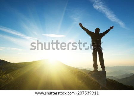 Winner on mountain top. Sport and active life concept  - stock photo
