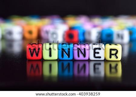 Winner on wooden table - stock photo