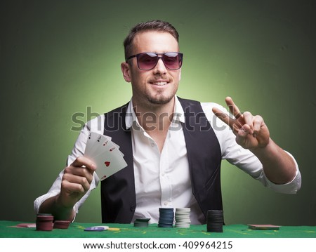 Winner poker player at the table - stock photo
