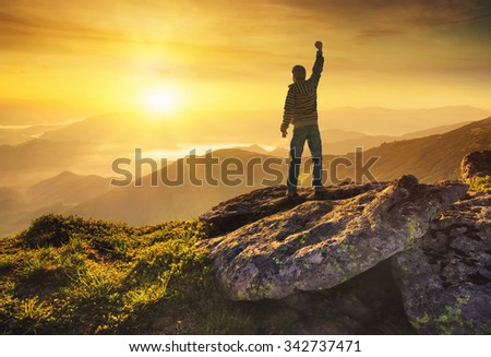 Winner silhouette on the mountain top. Sport and active life concept