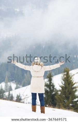 Winner / Success concept. Girl in mountain - stock photo