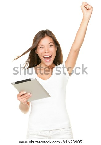 winner woman excited holding tablet pc isolated on white background. Cheerful happy fresh Asian Caucasian female model. - stock photo