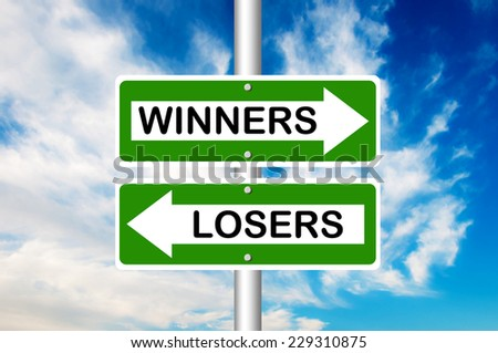 Winners and Losers Road Sign. Crossroads with a blue sky in a background - stock photo