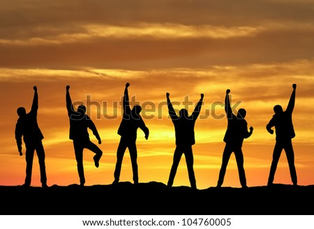 Winners on mountain summit. Sport and active life - stock photo