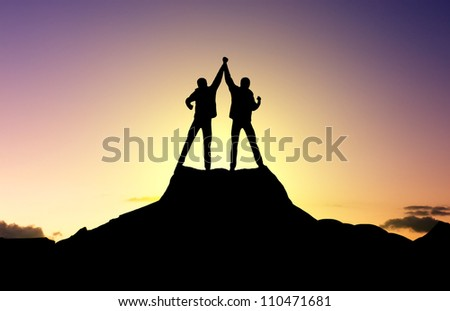 Winners on top of mountains. Sport and active life - stock photo