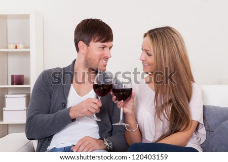 Winners tossed red wine to celebrate victory. - stock photo