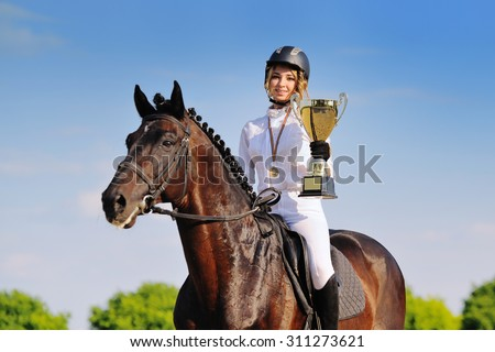 Winners - young girl and bay horse - stock photo