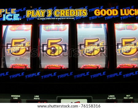 winning a one thousand dollar jackpot at a nearby casino - stock photo
