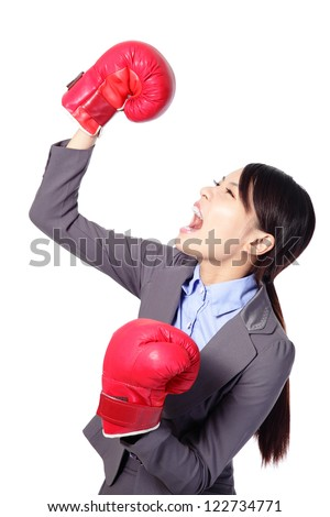 Winning business woman celebrating wearing boxing gloves and business suit. Winner and business success concept isolated on white background. asian beauty model - stock photo