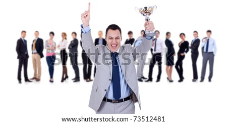 winning businessteam with male executive holding a gold trophy
