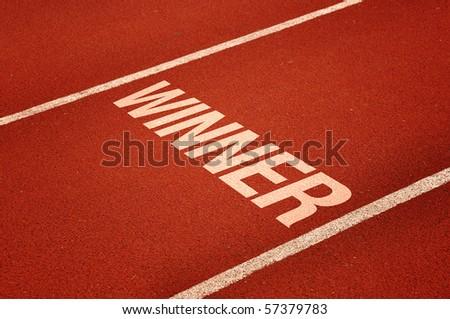 Winning lane, red tartan athletic track on the stadium. Sport winner concept. - stock photo