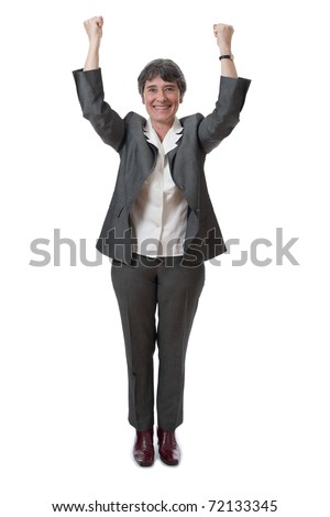 winning mature businesswoman with arms up isolated on white - stock photo