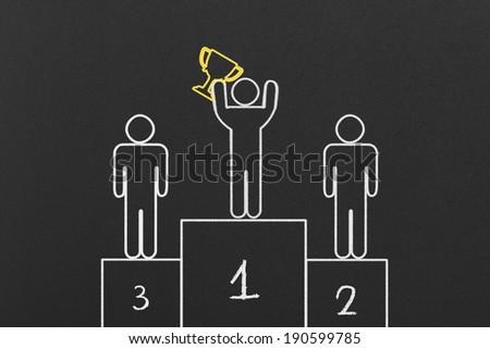 Winning Pedestal on Black Chalkboard - stock photo