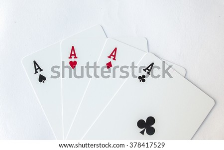 Winning Poker Hand of Four Aces Gamble Playing Cards Suit on White Background - stock photo