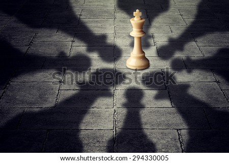 Winning together business team symbol teaming up to defeat a powerful opponent with eight chess pawns encircling the competition forming strong partnership that succeeds over the king as group - stock photo