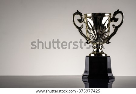 winning trophy championship award - stock photo