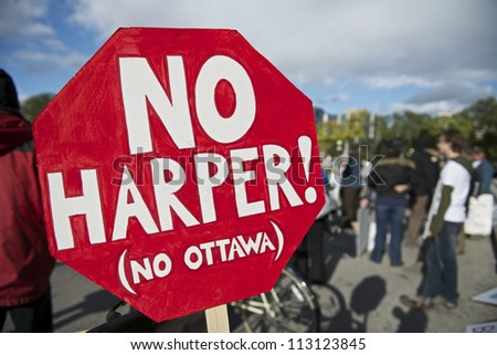 WINNIPEG, CANADA - SEPTEMBER 17: A sign decrying Prime Minister Stephen Harper is displayed at an Occupy Winnipeg observance of the anniversary of Occupy Wall Street on September 17, 2012 in Winnipeg. - stock photo