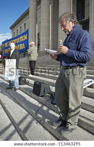 WINNIPEG, CANADA - SEPTEMBER 17: Darrell Rankin, a Communist Party of Canada leader, speaks to Occupy Winnipeg members marking Occupy Wall Street's anniversary on September 17, 2012 in Winnipeg. - stock photo