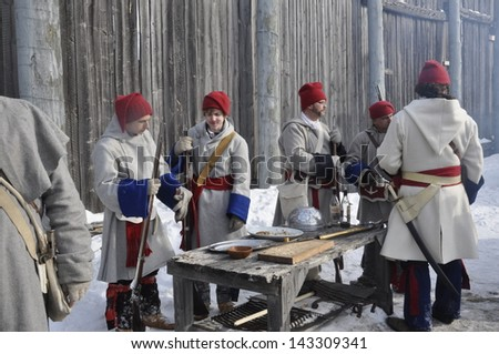 WINNIPEG, MB - FEBRUARY 24: Historic soldiers from the 2012 Festival du Voyageur, Winnipeg's winter festival celebrating the French Canadian culture. February 24, 2013 in Winnipeg, Manitoba - stock photo
