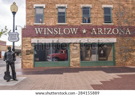 """WINSLOW, AZ/USA - April 17: """"Standin' On The Corner Park"""", pays homage to """"Take It Easy"""" a song written by Jackson Browne and popularized by the rock group Eagles, on April 17, 2015, in Winslow, AZ. - stock photo"""