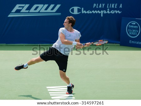 WINSTON-SALEM, NC, USA - AUGUST 24: Ernests Gulbis plays center court at the Winston-Salem Open on August 24, 2015 in Winston-Salem, NC, USA