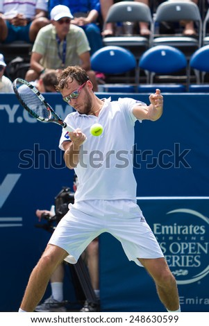 WINSTON-SALEM, NC, USA - AUGUST 23: Jerzy Janowicz plays center court at the Winston-Salem Open during a loss to Lukas Rosol in 3 sets on August 23, 2014 in Winston-Salem, NC, USA - stock photo
