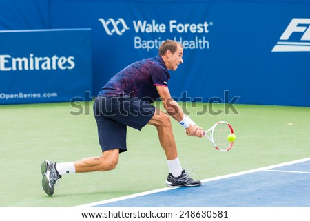 WINSTON-SALEM, NC, USA - AUGUST 23: Lukas Rosol plays center court at the Winston-Salem Open during his 3-set win over Jerzey Jankowicz on August 23, 2014 in Winston-Salem, NC, USA - stock photo