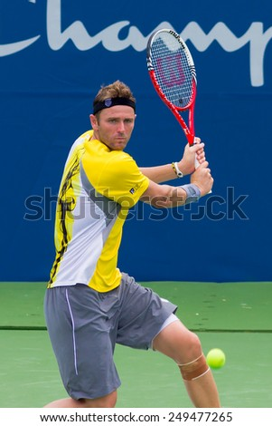 WINSTON-SALEM, NC, USA - AUGUST 20: Mardy Fish plays in his last game before his retirement at the Winston-Salem Open on August 20, 2013 in Winston-Salem, NC, USA. - stock photo
