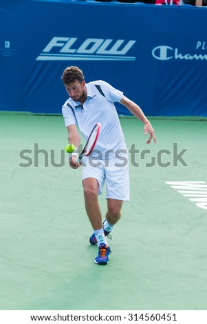WINSTON-SALEM, NC, USA - AUGUST 23: Robin Haase plays center court at the Winston-Salem Open on August 23, 2015 in Winston-Salem, NC, USA