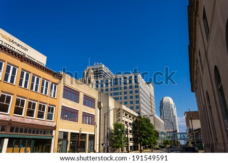 WINSTON-SALEM, NC, USA JUNE 3: Winston-Salem Downtown from Liberty Street on June 3, 2013 in Winston-Salem, NC. Including R. J. Reynolds, Winston Tower, One West Fourth Street and Wells Fargo Center. - stock photo