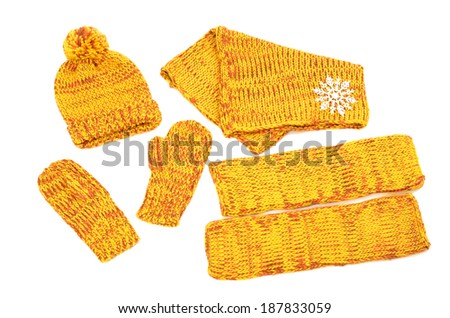 Winter accessories isolated on white background. Matching yellow neck wear, a pair of mittens, a hat and leg warmers nicely arranged.  - stock photo