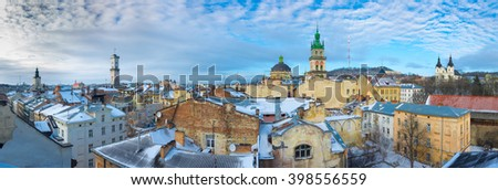 Winter aereal panoramic view of Old Town in Lviv with church and houses of the historical medieval part of the city. Ukraine. - stock photo