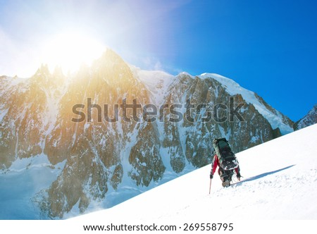 Winter alpine trekking - stock photo