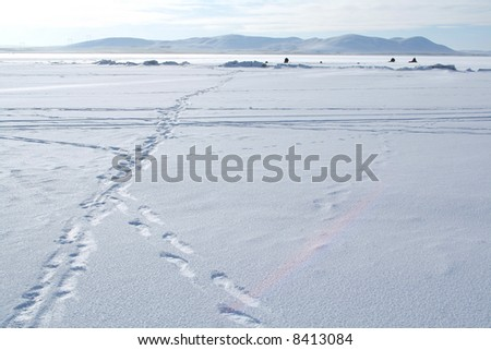 Winter Arctic landscape with fishermen