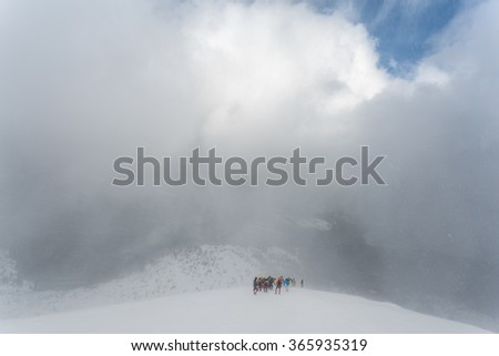 Winter ascent of the mountain climbers in the snow storm (blizzard). Carpathian, Ukraine, Europe.  (hi res, high quality)