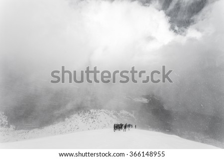 Winter ascent of the mountain climbers in the snow storm (blizzard). Carpathian, Ukraine, Europe - stock photo