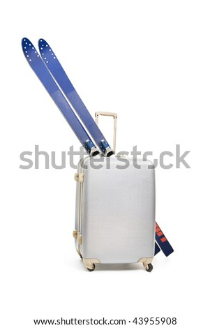 Winter at the door -Travel bag and skis - stock photo