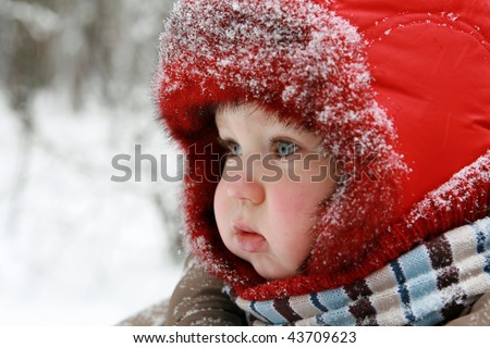 Winter baby. One year old baby dressed in warm clothing.